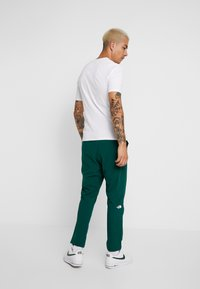 The North Face - TECH PANT - Trainingsbroek - night green - 2