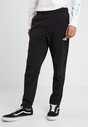 TECH PANT - Verryttelyhousut - black/white