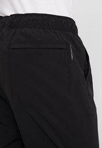 The North Face - TECH PANT - Trainingsbroek - black/white - 4