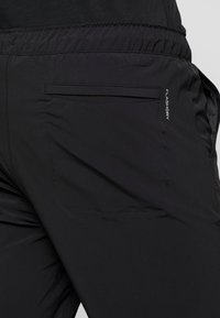 The North Face - TECH PANT - Spodnie treningowe - black - 3