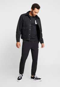 The North Face - TECH PANT - Spodnie treningowe - black - 1