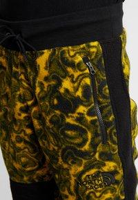The North Face - RAGE CLASSIC PANT - Spodnie treningowe - leopard yellow - 4