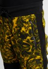 The North Face - RAGE CLASSIC PANT - Spodnie treningowe - leopard yellow