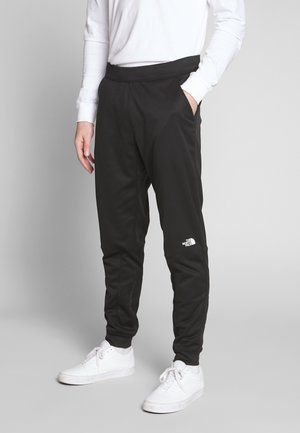 TRAIN LOGO PANT - Tracksuit bottoms - black