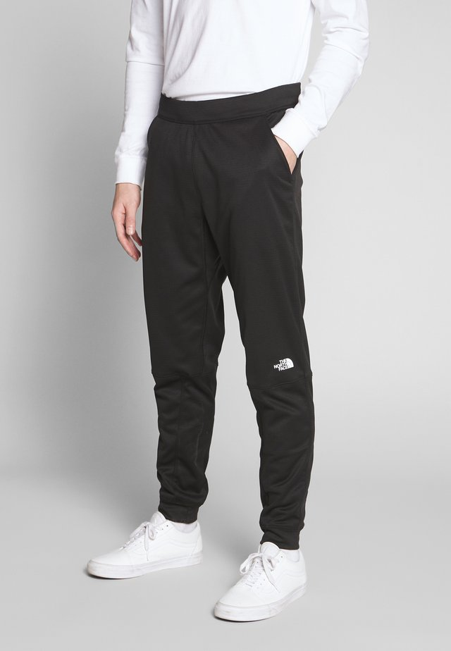 TRAIN LOGO PANT - Pantalones deportivos - black
