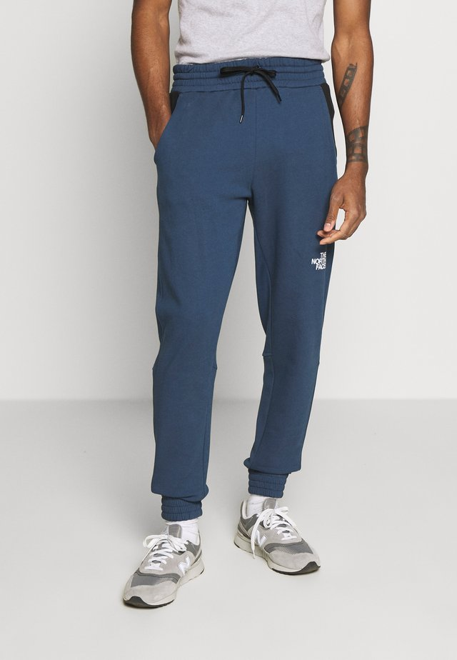 STANDARD PANT - Tracksuit bottoms - blue wing teal