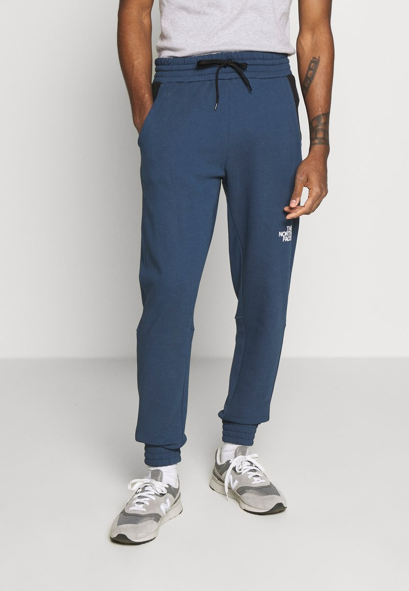 The North Face - STANDARD PANT - Tracksuit bottoms - blue wing teal