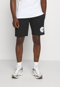 The North Face - GEODOME - Tracksuit bottoms - black - 0