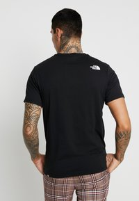 The North Face - FINE TEE - T-shirt print - black - 2