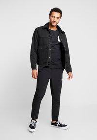 The North Face - FINE - Bluzka z długim rękawem - black/white - 1