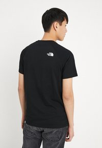 The North Face - RAG DO TEE - Printtipaita - black