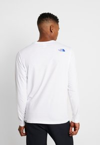 The North Face - FILLED LOGO TEE - T-shirt à manches longues - white - 2