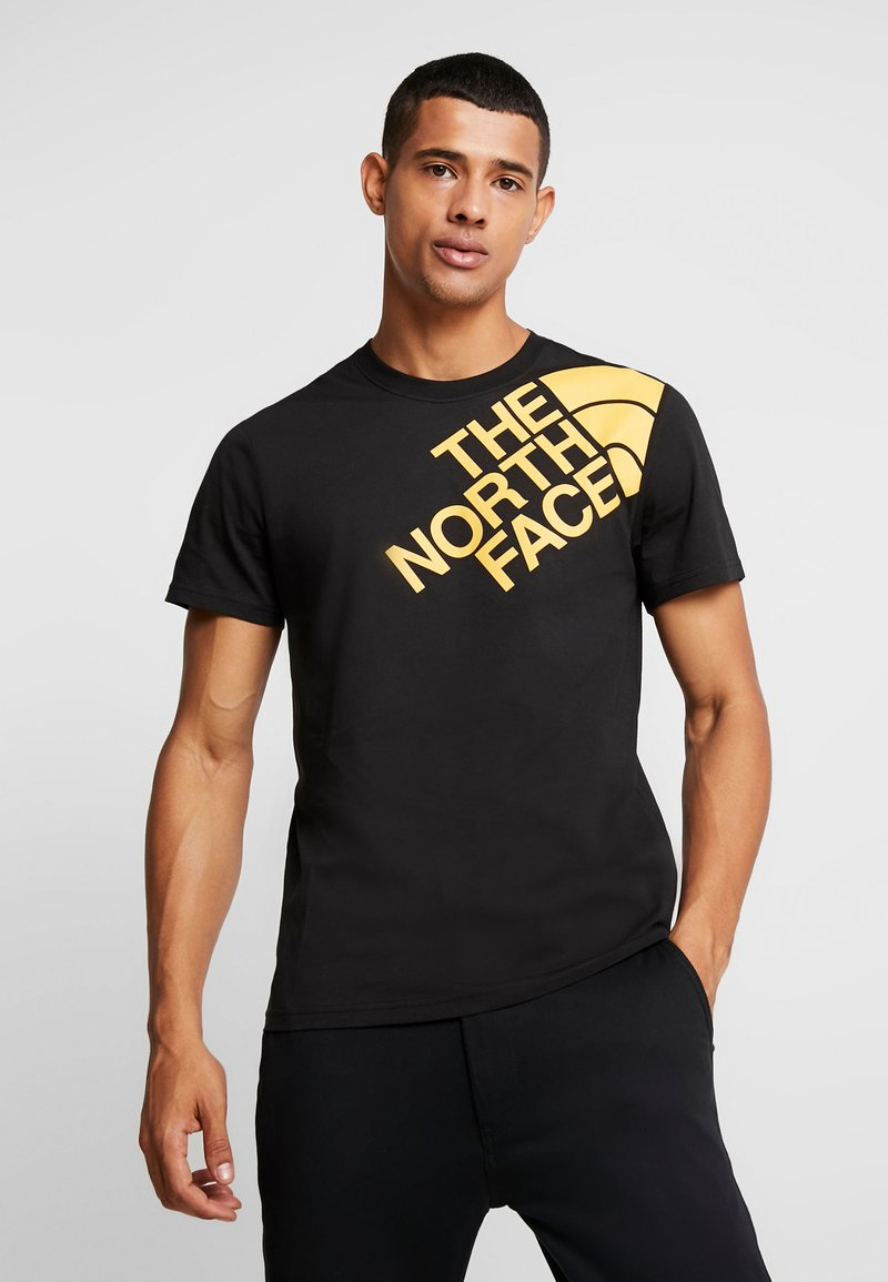 The North Face - SHOULDER LOGO TEE - T-shirt imprimé - black/yellow