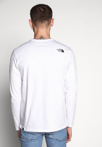 The North Face - GRAPHIC FLOW - Topper langermet - white/black - 2