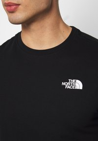 The North Face - PEAKS TEE - T-shirts med print - black - 3