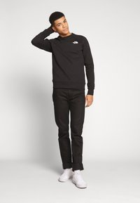 The North Face - RAGLAN BOX CREW - Bluza - black/white - 1