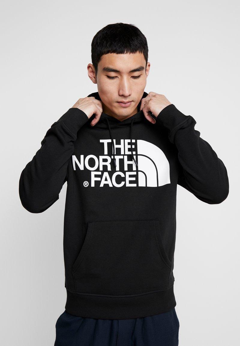 The North Face - STANDARD HOODIE - Bluza z kapturem - black