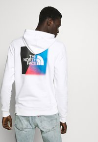 The North Face - GRAPHIC HOODIE - Mikina skapucí - white/ black - 2