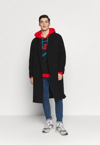 The North Face - EXTREME HOODIE - Huppari - black/fiery red/meridian blue - 1