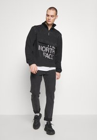 The North Face - GRAPHIC COLLECTION ZIP - Sweatshirt - black - 1
