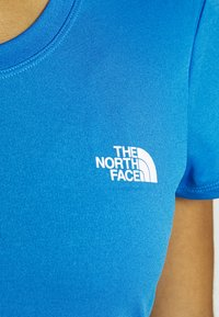 The North Face - WOMENS REAXION CREW - Basic T-shirt - clear lake blue heather - 4