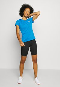 The North Face - WOMENS REAXION CREW - Basic T-shirt - clear lake blue heather - 1