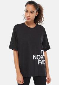 The North Face - W LIGHT S/S TEE - Print T-shirt - black - 0