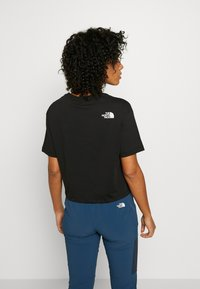 The North Face - CROPPED SIMPLE DOME TEE - T-shirt z nadrukiem - black - 2