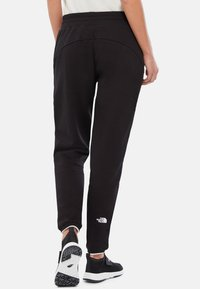 The North Face - W FINE PANT - Tracksuit bottoms - black - 1