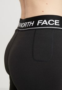 The North Face - FLEX - Legginsy - black/white