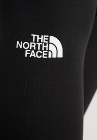 The North Face - FLEX - Legginsy - black/white - 6