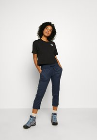 The North Face - WOMEN'S APHRODITE CAPRI - Outdoor-Hose - urban navy - 1