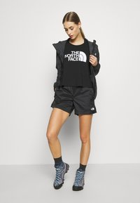 The North Face - WOMEN'S ACTIVE TRAIL BOXER SHORT - Sports shorts - black - 1