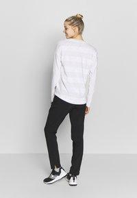 The North Face - WOMENS VARUNA PANT - Spodnie materiałowe - black - 2