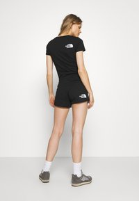 The North Face - RAINBOW SHORT - Sports shorts - black graphic - 2