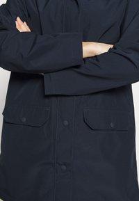 The North Face - WOMENS WOODMONT RAIN JACKET - Hardshell jacket - urban navy - 8