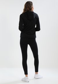 The North Face - WOMENS TECH MEZZALUNA HOODIE - Fleece jacket - black