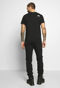 The North Face - WOODCUT DOME TEE - T-shirt med print - black - 2