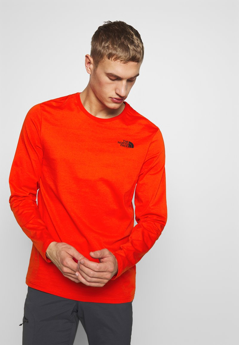 The North Face - Langærmede T-shirts - fiery red