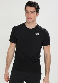 The North Face - CELEBRATION TEE - T-shirt z nadrukiem - black - 0