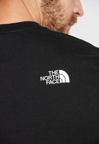 The North Face - FLASH TEE - T-shirts med print - black/white - 5