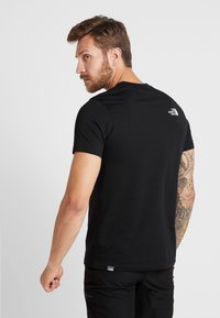 The North Face - FLASH TEE - T-shirts med print - black/white - 2