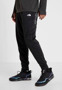 The North Face - LOGO JOGGER - Spodnie treningowe - black - 0