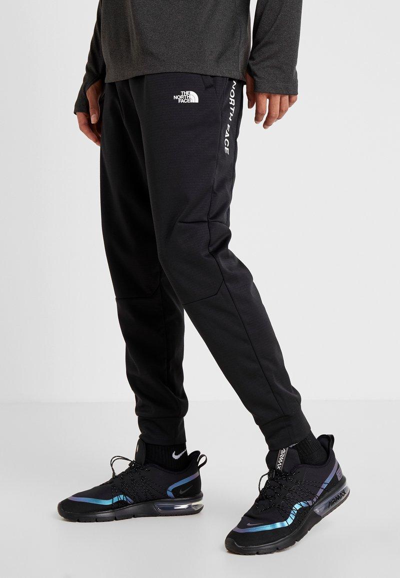 The North Face - LOGO JOGGER - Spodnie treningowe - black