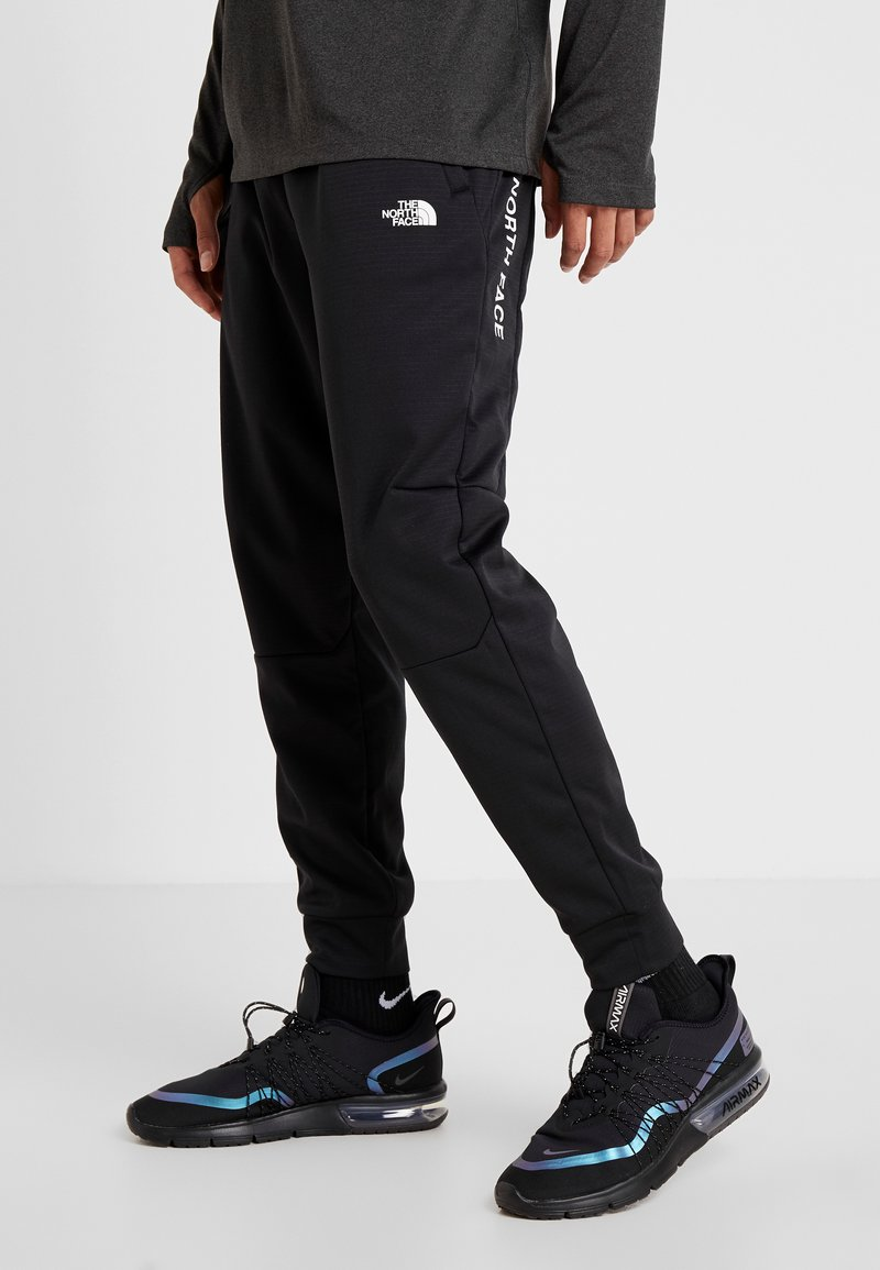 The North Face - LOGO JOGGER - Tracksuit bottoms - black