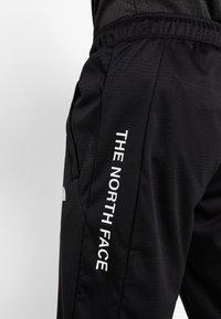 The North Face - LOGO JOGGER - Spodnie treningowe - black - 5
