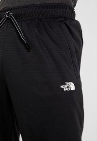 The North Face - LOGO JOGGER - Spodnie treningowe - black - 3