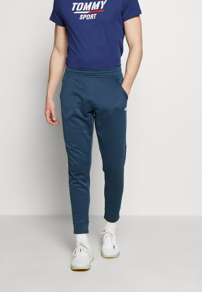 The North Face - MENS SURGENT CUFFED PANT - Spodnie treningowe - blue wing teal heather