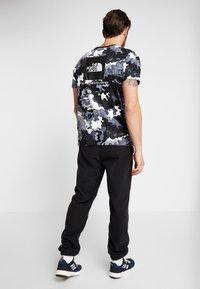 The North Face - GLACIER PANT - Pantalon de survêtement - black - 2