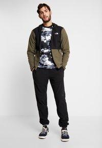 The North Face - GLACIER PANT - Pantalon de survêtement - black - 1